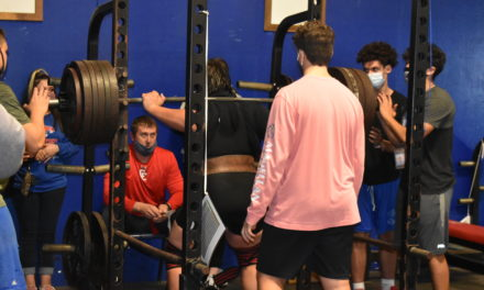 Boys' powerlifting team claims 8th place at regional competition, Byrne advances to state meet